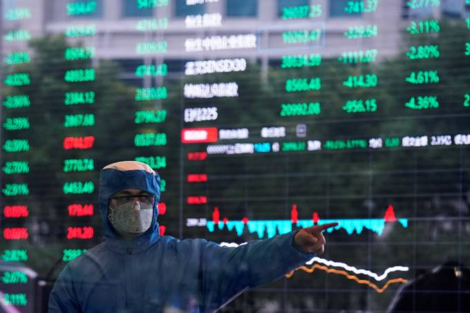 Covid-19: novos casos aumentam na China e bolsas fecham em queda